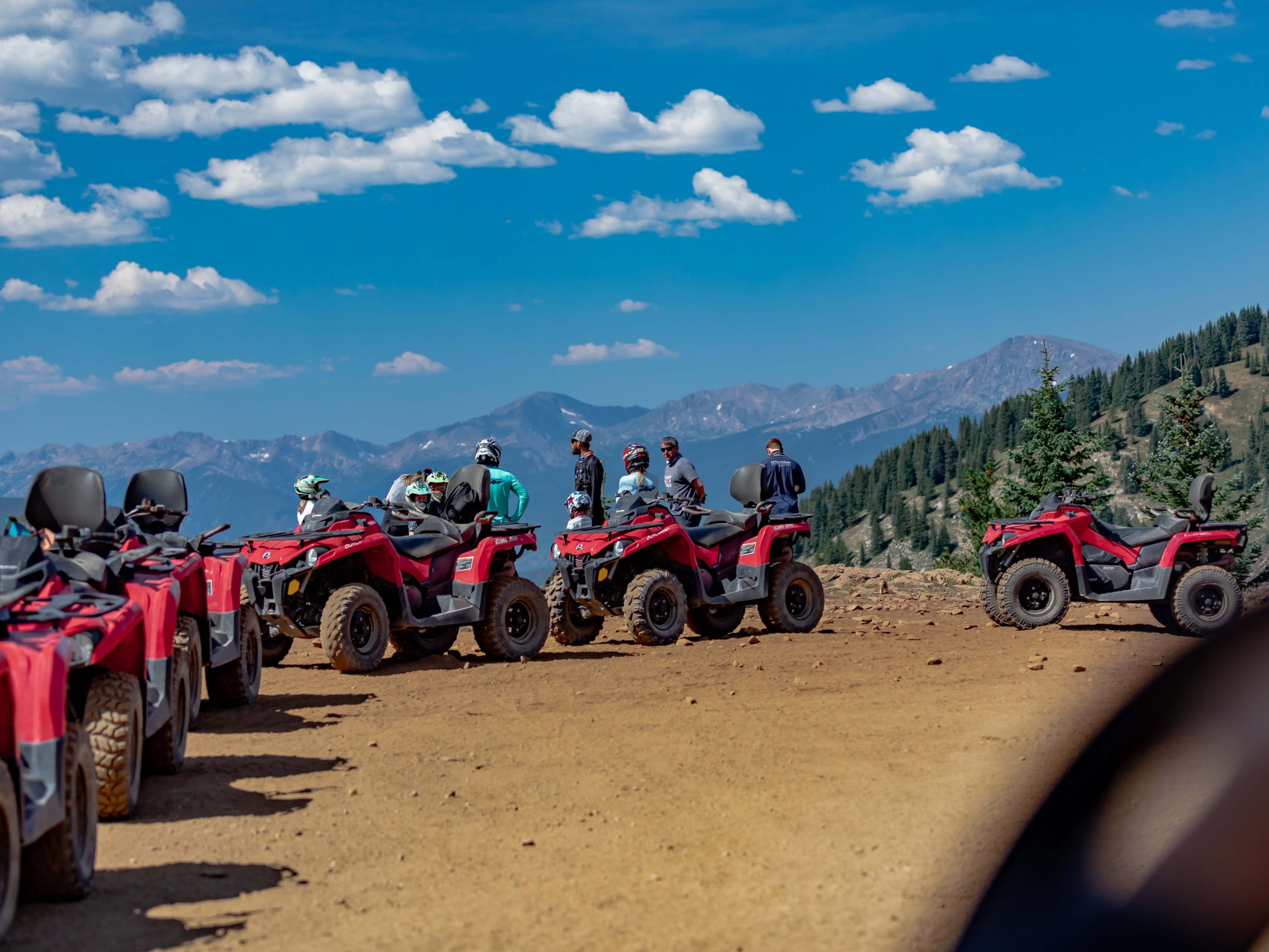 group riding ATV at the top of the mountain