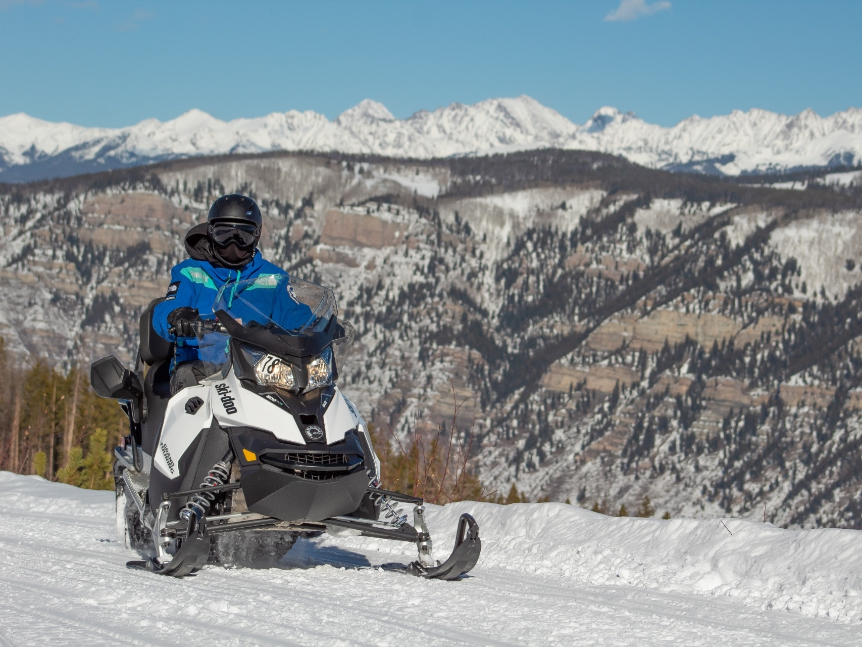 Riding 2 up on Ski-Doo in the mountains