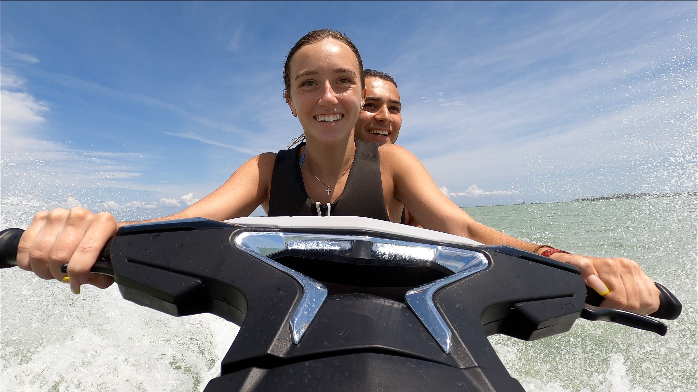 2 people riding a Sea-Doo
