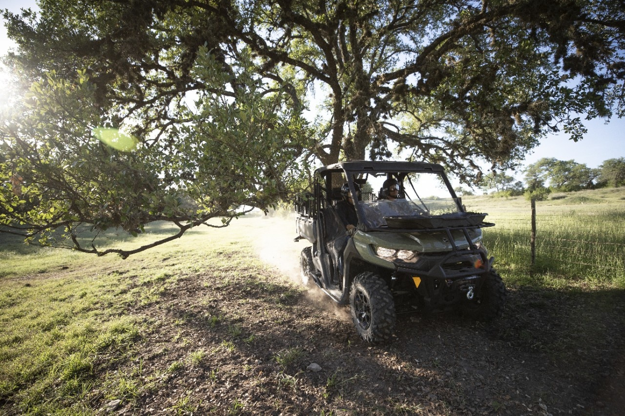Can-Am Defender riding in trails