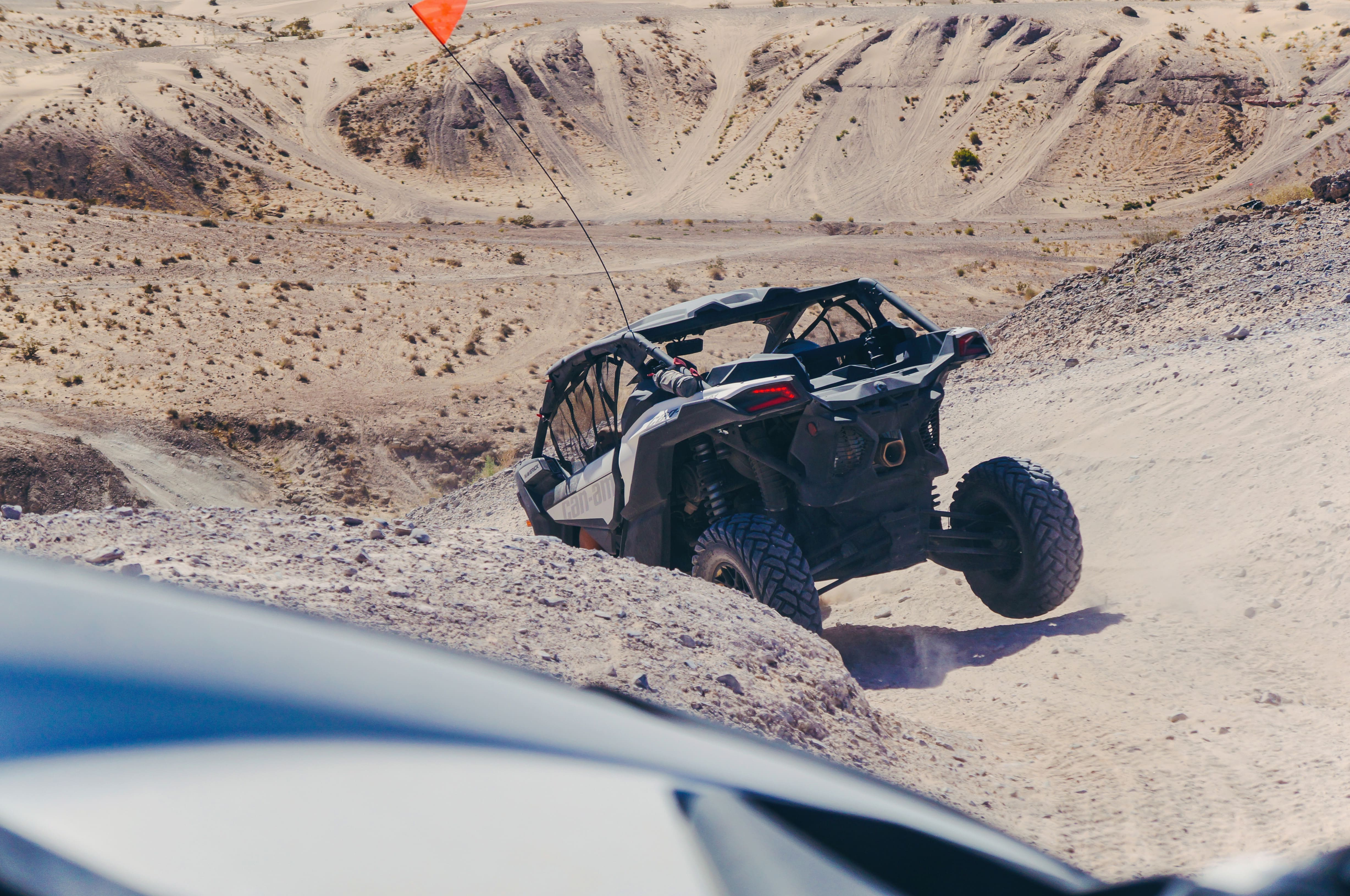 Riding a Maverick X3 in the desert
